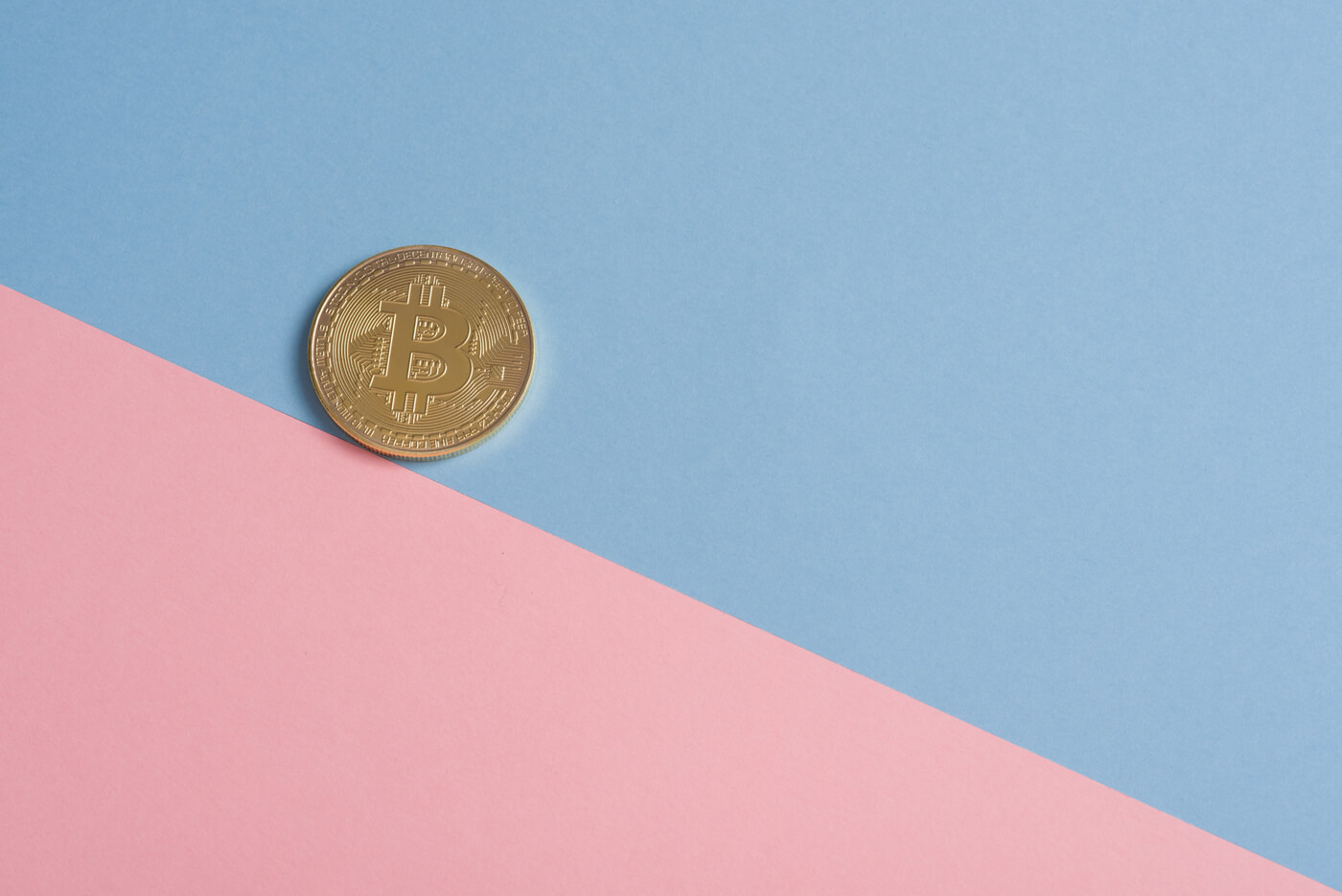 a coin on blue and pink background