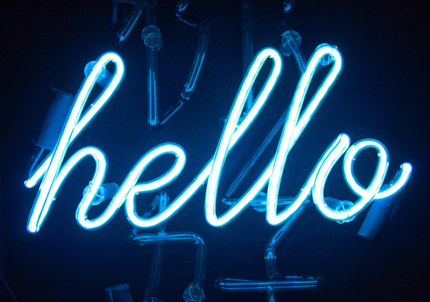 a neon sign 'hello'