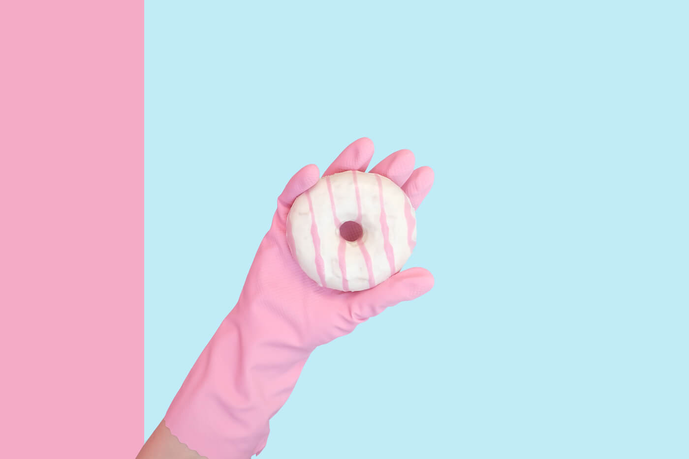 a hand holding a donut