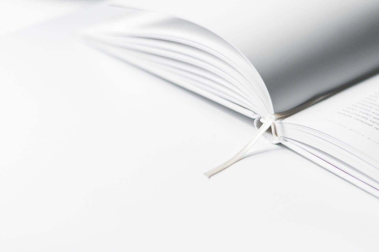 an open white book on a white background