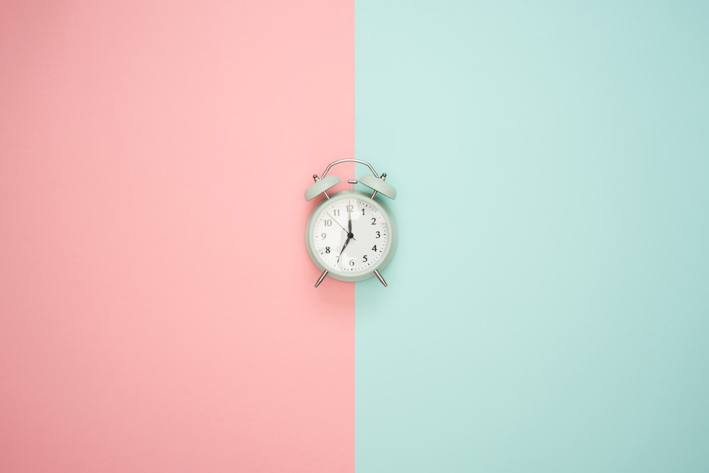 a clock on blue and pink background
